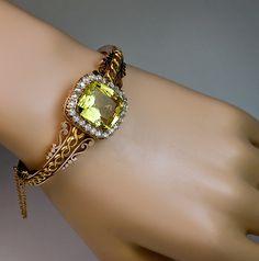 Creator: Unknown Stone(s): Yellow Beryl, Diamond Metal: Rose and Yellow Gold Source: Romanov Russia