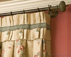Traditional window treatment accented by decorative hardware