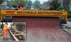 Follow the self-made road: Incredible machine that lays out a carpet of bricks removing back-breaking hard work