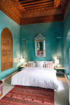 Moroccan Themed Bedroom With Ornate Wall Mirror And Blue Wall Colors : Creating An Exotic Moroccan Themed Bedroom