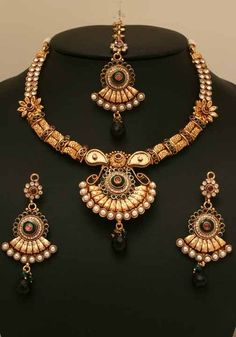 Handcrafted Indian Gold plated Emerald,Imitation pearls and clear stones Polki set -06PLKF26  http://www.craftandjewel.com/servlet/the-1608/Handcrafted-Indian-Gold-plated/Detail