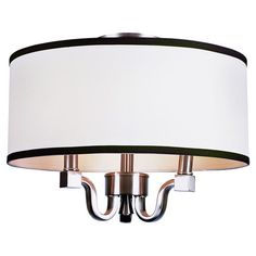 Three-light chandelier with a drum shade and contrasting trim.  Product: ChandelierConstruction Material: Metal and f...