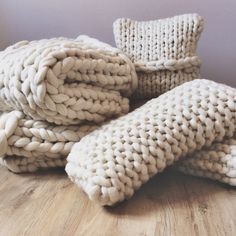 All hand knit by Lauren Aston Designs a selection of chunky knit cushions and blankets in natural white, super soft merino wool.