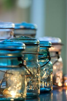 Wanted: authentic turquoise canning jars. Tip- some sand at the bottom will keep the heat from breaking the jars when the candles are low. Christmas Lights In Jars, Bottles And Jars, Glass Bottles, Mason Jar Crafts, Mason Jars, Sunday Photos, Pots, Vintage Jars, Mason Jar Lighting