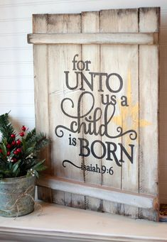 For unto us a child is born Isaiah 9:6 on reclaimed pallet wood sign  Item measures 26 x 18. Colors:  Board is antique white  Large star in gold