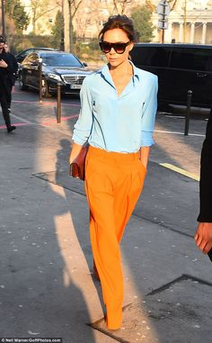 Be bold in Victoria's wide-leg orange trousers #DailyMail