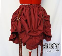 Interesting way to hitch up a skirt.