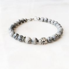White Skull Bead Bracelet http://www.thesterlingsilver.com/product/hoxton-london-mens-sterling-silver-bamboo-woven-pattern-silver-and-leather-bracelet/