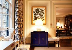 love the cabinet color and drapes
