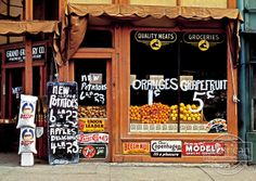 Grand Grocery Co., Lincoln, Nebraska.Photograph shows Rice Krispies cereal boxes in window below oranges; Better Loaf flour sacks at left n...