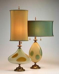 """""""Lucy & Ethel"""" table lamps created by Caryn Kinzig & Susan Kinzig. Table lamp with elongated tear-drop shaped creamy glass with random teal dots. Antique Lamps, Vintage Lamps, Vintage Table, Vintage Lighting, Chandelier Lamp, Chandeliers, Ceiling Lamps, Pendant Lamps, Pendant Lights"""