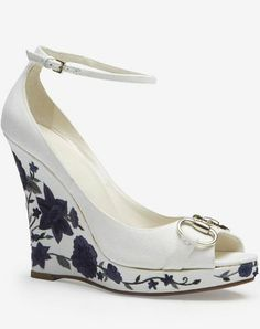 Gucci White Floral Wedge Sandal.  Not a huge fan of ankle straps but this is pretty.