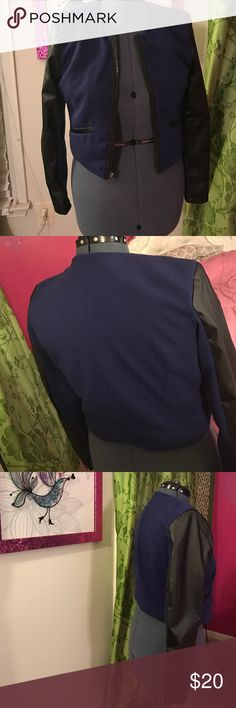 Jacket with faux leather sleeves This is a navy jacket with black faux leather sleeves. Jackets & Coats
