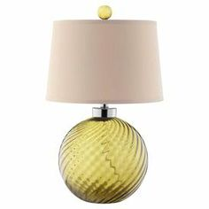 "Green table lamp with an ivory-hued shade.Product: Table lamp  Construction Material: Glass and fabric  Color: Green and ivory   Features: Hardback shade Coordinating finial3-Way switch Accommodates: (1) 100 Watt bulb - not includedDimensions: 24"" H x 15"" Diameter"
