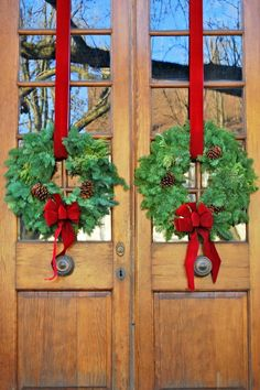 I love double doors ~ especially when they are decorated with double wreaths! These feature traditional greenery, a few pinecones and lush red velvet ribbons and bows. What better way to say 'Merry Christmas!'?