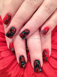 Red and black polish with freehand rose nail art
