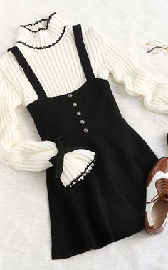 Warm, chic & cute. Strap suiting buttons flare suspenders black skirt with cute sweater outfit.