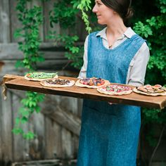 Handmade in Hungary from reclaimed European pine, this extra-large serving board is over three feet long. Ideal for use as a centerpiece or serving bo