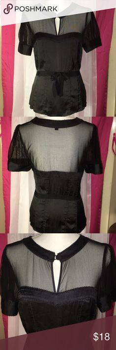 NWOT BEBE SEE THRU BLACK SEE THRU BLOUSE SZ MED This beautiful blouse is see-through on the top in the back and it has a tie in the front is a satin like fabric and it's a size medium and 26 inches from the shoulders and simply gorgeous! bebe Tops Blouses