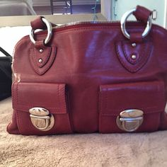 Marc Jacobs Blake Bag in Brick Red AUTHENTIC Beautiful Marc Jacobs bag not used as much as I wanted since it's so expensive and I always worried about it! It is still well loved. Slight scrape on back as shown in picture also stain inside on bottom also shown. Comes with Dust Bag.  Make me an offer! Marc Jacobs Bags Satchels