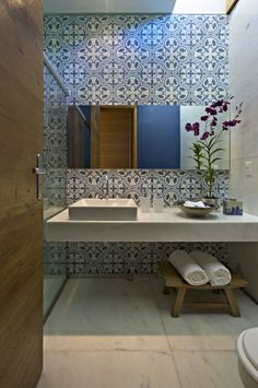 Inspiration from Bathrooms.com: In a boxy room with few redeeming features, choose show-stopping tiles that make a plain wall a feature in itself. We love these Moroccan style tiles, matched with contemporary fittings. #ensuitebathrooms #bathrooms #tiles