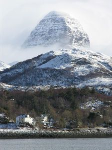 Suilven from Lochinver may be only 731 meters high, but its unique outline, challenging remoteness and superlative views make it one of the finest mountains in the Scottish Highland.