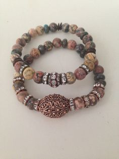 Natural Czech Beaded BraceletGreen Brown by GEOjewelrydesigns, $45.00 (Normally, I wouldn't include a stretch bracelet, but these call to me.)