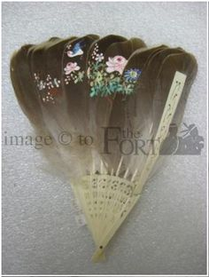 FM.81.170.29    Gray feather and ivory ladies evening fan.  The fan consists of 16 carved lacework struts with medium gray feathers attached, downy at base.  The centre of the fan has been hand painted in the Japanese floral style.