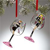 "Personalized Christmas Ornaments - Wine Glass Diva - Brunette. Add a little cheer to her holiday tree with this fun and funky Wine Diva Mini-Wine Glass Ornament; the perfect Christmas gift for any Vixen on your list! Choose brunette or blond hair color. This festive design features a sexy wine lover on the front, accented with wine bottles and grapes. Delicately Hand-Painted from top to bottom, including the stem of the glass. Measures 4 1/2"" in height. Includes holiday ribb. Price: $16.95"