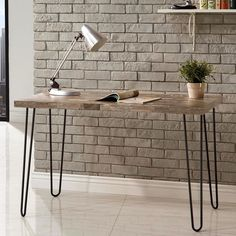 A Salvaged Cabin finish on the wood top gives the piece a rustic appearance, while the hairpin metal legs suggest urban industrial style. With an airy and open design, this desk is a great option for a smaller space or any room.
