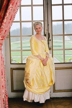 Kirsten Dunst, in yellow satin, as Marie-Antoinette.