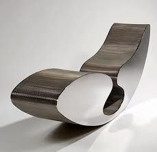 Informalist chair by Ron Arad. The body has been constructed from metal and lined with wood. This object of comfort has been created by industrial materials.