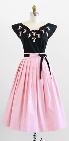 vintage 1950s pink + black top + skirt dress set with people shaped lace appliqués | http://www.rococovintage.com