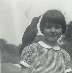 """My pet jackdaw Jim perched on my sister's shoulder. A picture of Bay Baddeley snapped by my mother in 1951, when she and my mum visited my boarding school - Ashfold - in Sussex."" Simon Baddeley"