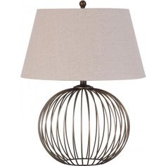 """This metal cage round body is finished in an antique brass. The shade is a bell linen oatmeal fabric.  <b>Material: Metal</b>  Base: 6.5""""Dia"""