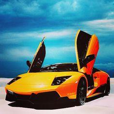 Vibrant Orange Lamborghini Murcielago absorbing in the great view!