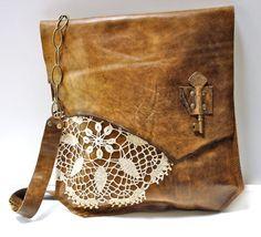 Brown leather purse with white or cream colored lace