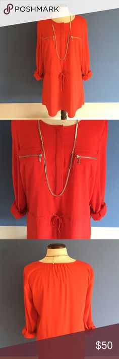 """📍New Listing📍🆕INC Cherry Red Blouse NWOT - Red is HOT!  This blouse is sure to stand out in the crowd.   There are hidden buttons at the top middle.  Silver zippers are placed on the breast pockets.  There is also a tie at the waist for the perfect fit.  Pair with leggings and boots and you have a great outfit.  Material: 97% Polyester/3% Spandex. Measurements:  Length - 31""""/Bust - 20""""/Waist - 20"""" Max (can be tightened with tie) INC International Concepts Tops Blouses"""