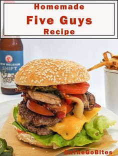 We tell you how to make Five Guys Burgers. Cheeseburger, burger or bacon burger. Using good ground beef with toppings like bacon, grilled onions and mushrooms. Use a cast iron pan or heavy skillet or griddle and smash away! OnTheGoBites.Com #burgerrecipes #fiveguysburgers #smashburgers