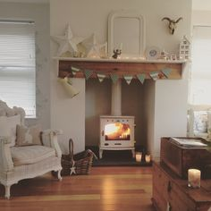 Cosy home with wood burner and arm chair Cottage Living Rooms, Cottage Interiors, New Living Room, Home And Living, Living Room Decor, Shabby, Cosy Cottage, Cosy Home, Style Vintage