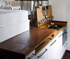 Here's another way to hide the kitchen: put it under the floor : TreeHugger