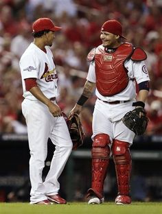 catcher Yadier Molina congratulates relief pitcher Carlos Martinez after Martinez threw out Pittsburgh Pirates' Russell Martin in the top of the eighth inning of Game 1 of the NLDS...fantastic play.. Cards won 9-1.  10-03-13