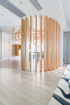 PplusP Designers have recently completed the interior design for their project Deep In Nature, an apartment in Macau.  modern wood room divider