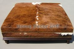 Exclusive Custom Made Cowhide Ottomans -