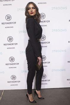 Olivia Cuplo in a black catsuit