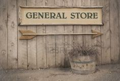 A vintage sign pointing to a General Store  Wild West theme   Stock Photo