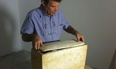 "Tel Aviv antiquities collector Oded Golan with the stone burial box bearing the inscription ""James, son of Joseph, brother of Jesus."" Photog..."