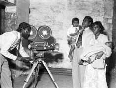 Aboriginal actor Robert Tudawali (Marbuck) steps behind the camera at Avondale Studios, Sydney, prior to filming of Jedda. 1953.
