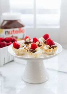 A recipe for Nutella Greek Yogurt Fillo Cups with fresh Raspberries and Almonds -- light, creamy, and so simple to make, it's perfect for entertaining.