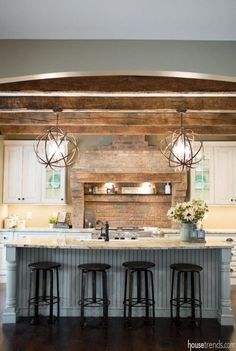 Despite paying homage to the home's history the kitchen design doesn't sacrifice the convenient comforts of modern amenities. Despite paying homage to the home& history the kitchen design doesn& sacrifice the convenient comforts of modern amenities. Home Interior, Interior Design, Kitchen Interior, Home History, House Ideas, Rustic Lighting, Lighting Ideas, Kitchen Lighting, Cottage Lighting